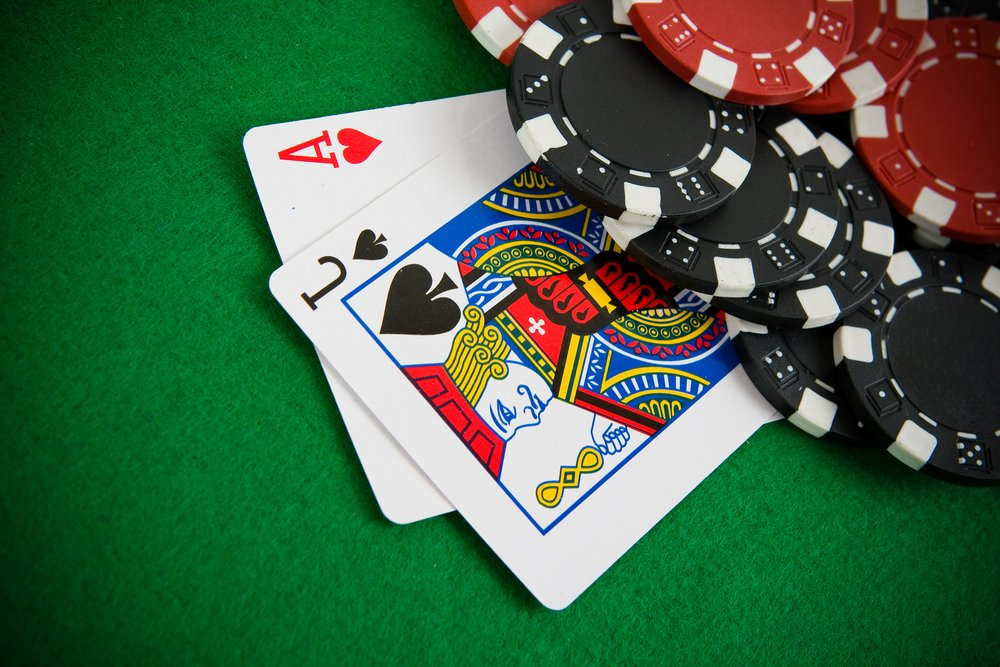Ace of hearts and black jack with Chips